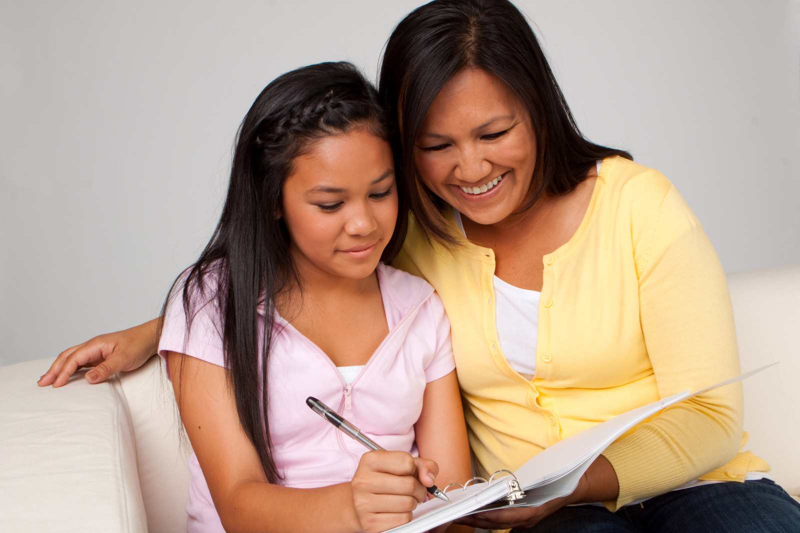 mother teaching daughter